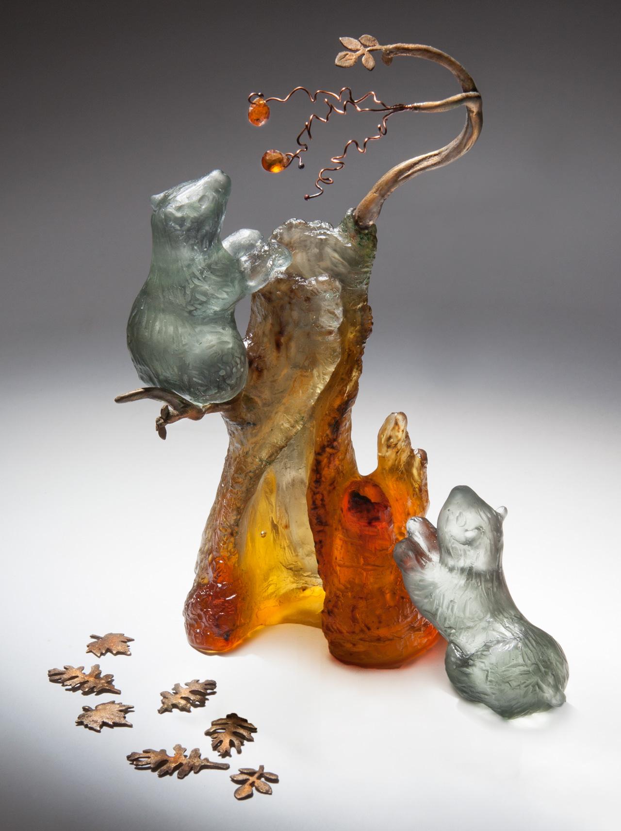 glass sculpture: bears climbing tree for fruit