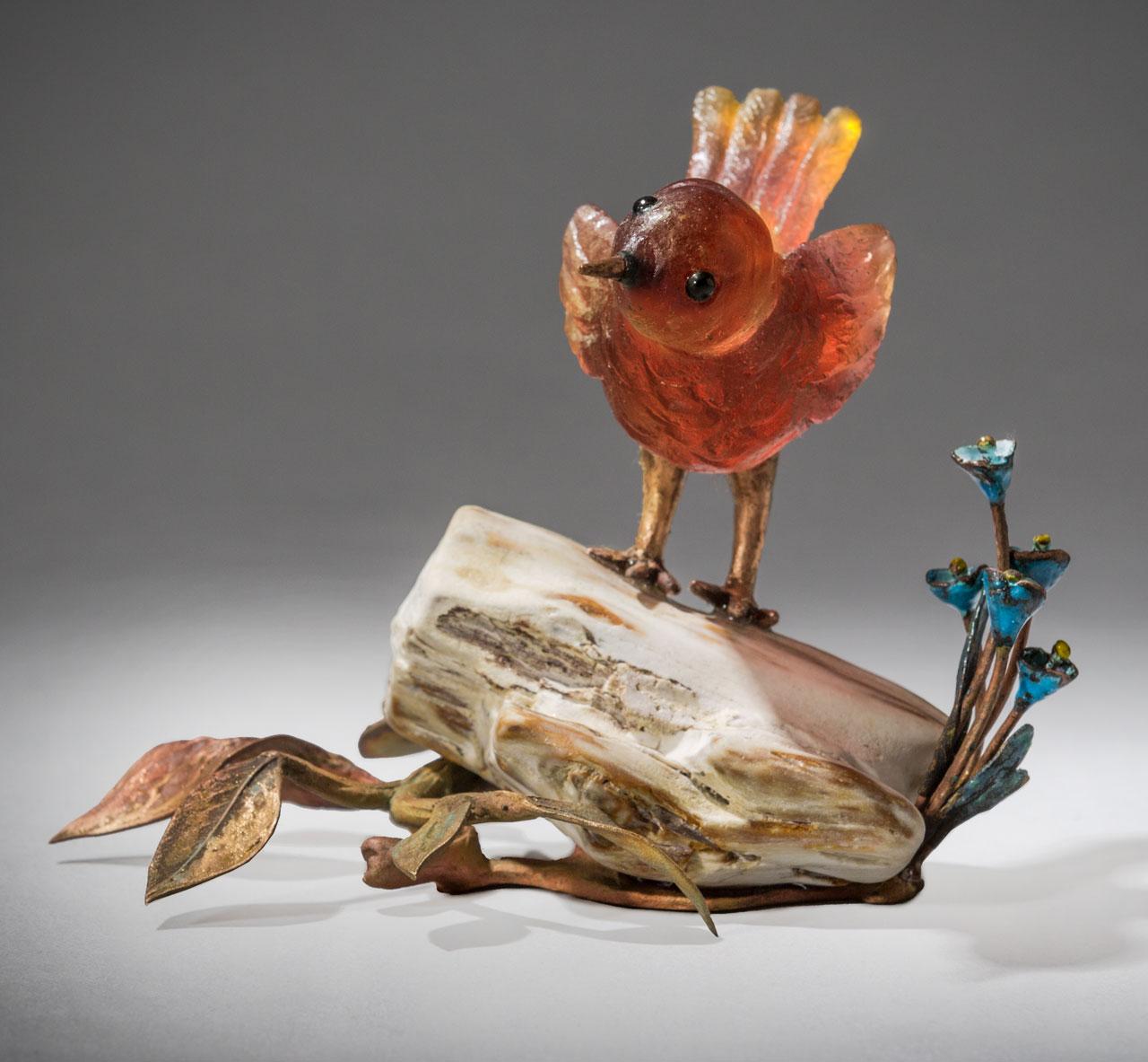 glass sculpture: red bird on log